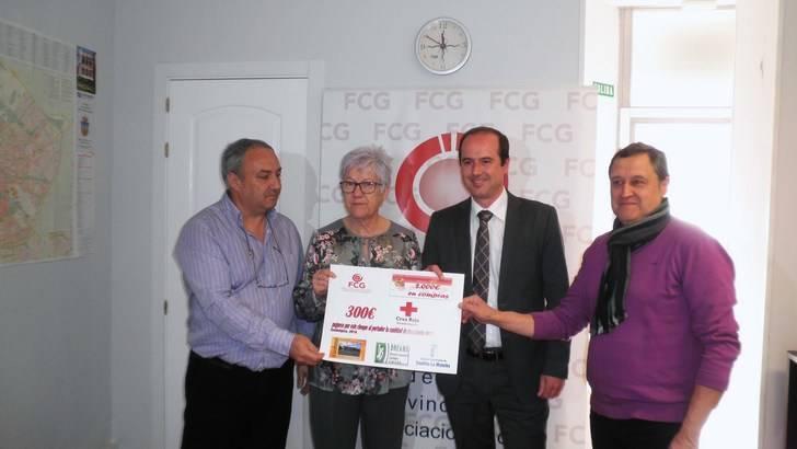 FCG colabora con Cruz Roja con un cheque de 300 euros de su campaña Reyes Millonarios